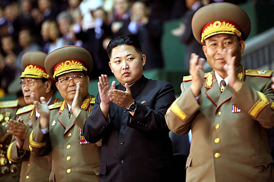 In this photo taken on Saturday, Oct. 9, 2010 released by China's Xinhua News Agency, Kim Jong Un, third from left, the third son of North Korean Leader Kim Jong Il,  applauds while watching the Arirang mass games performance staged to celebrate the 65th anniversary of the founding of the Workers' Party of Korea, in Pyongyang, North Korea. (AP Photo/Xinhua, Yao Dawei)