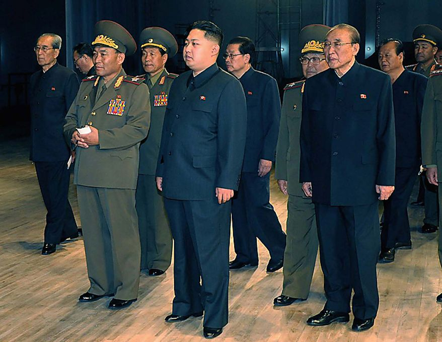 In this undated photo released by Korean Central News Agency via Korea News Service Saturday, Oct. 9, 2010, Kim Jong Un, center, the third son of North Korean leader Kim Jong Il inspects the newly-built State Theater in Pyongyang, North Korea's capital. (AP Photo/Korean Central News Agency via Korea News Service)