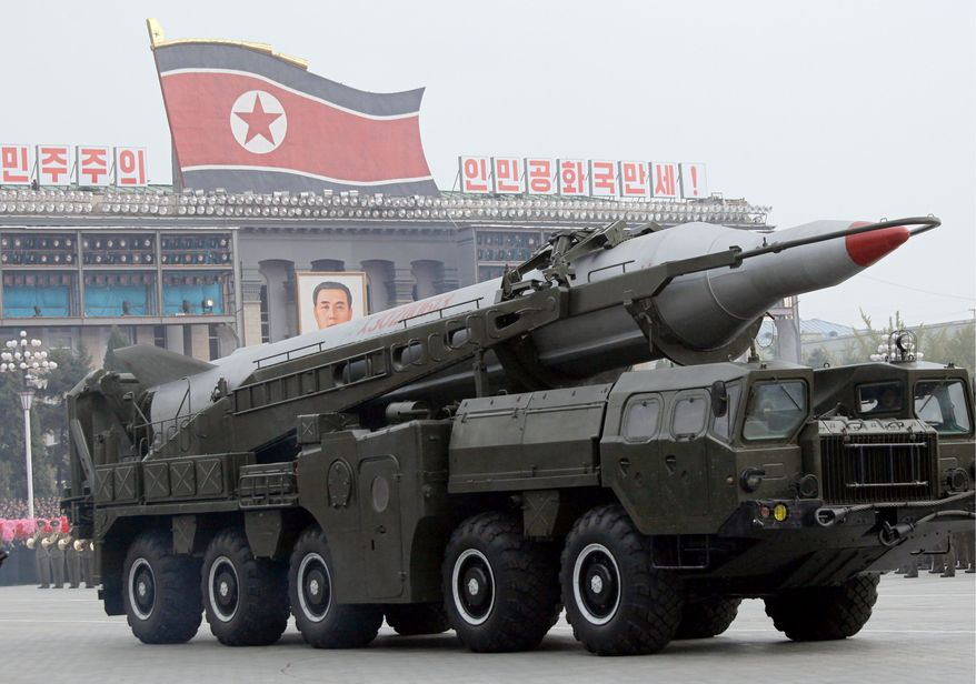 A North Korean missile on a carrier is part of a massive military parade Sunday to mark the 65th anniversary of the communist nation's ruling Workers' Party in Pyongyang, North Korea. This year's celebration came less than two weeks after Kim Jong-il's re-election to the party's top post and news that his 20-something son, Kim Jong-un, would succeed his father and grandfather as leader. (Associated Press)