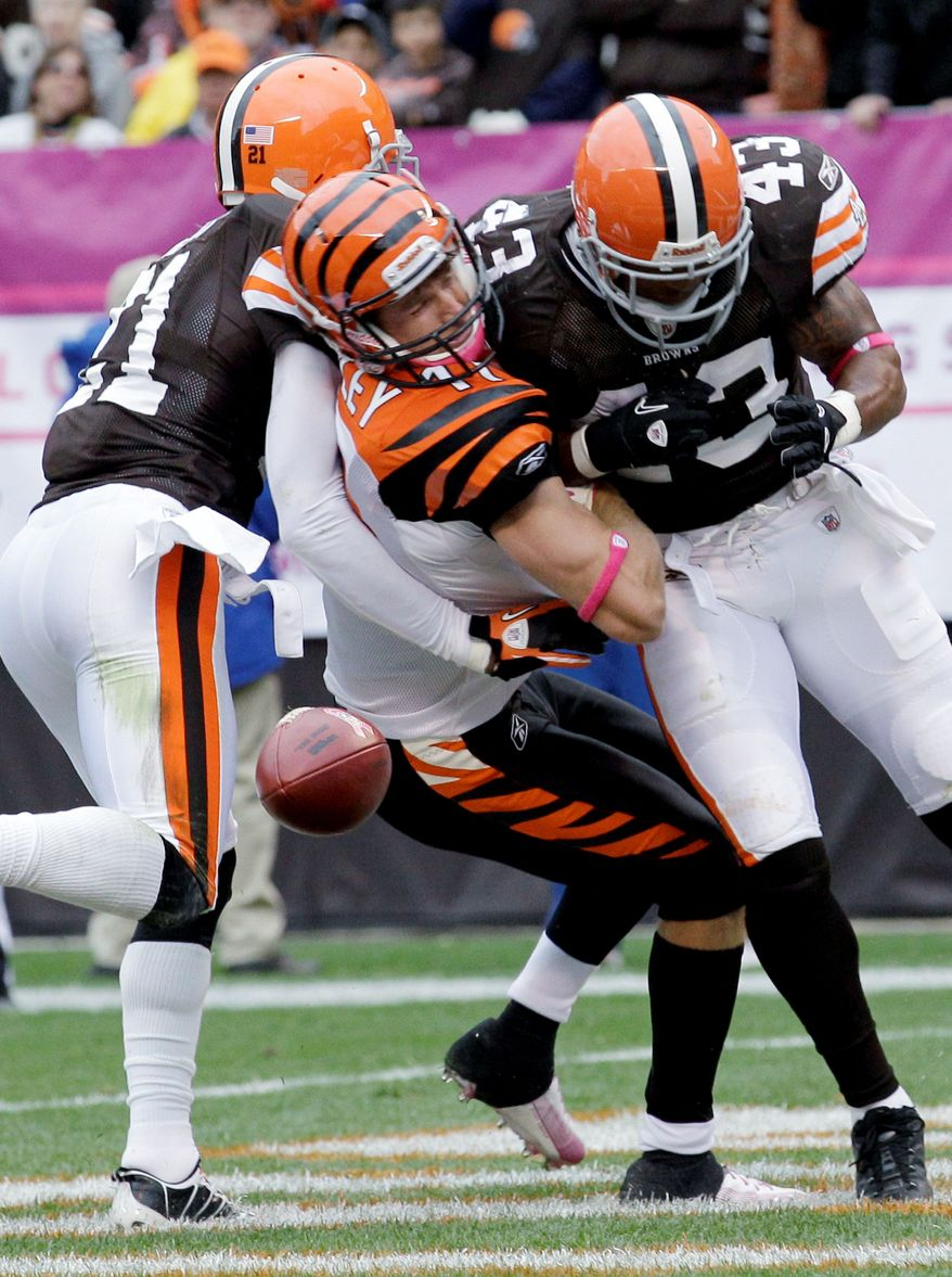 Cincinnati Bengals wide receiver Jordan Shipley (11) drops the ball as he is hit in the end zone between Cleveland Browns cornerback Eric Wright (left) and safety T.J. Ward (43) during an NFL football game in Cleveland earlier this month. The violent hit that left Shipley with a concussion was an illegal one, earning Ward a $15,000 fine. (Associated Press)