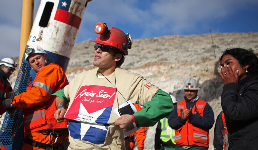 In this photo released by the Chilean government, miner Alex Vega reacts Wednesday after being rescued from the collapsed San Jose gold and copper mine near Copiapo, Chile, where he and 32 other miners had been trapped for more than two months. (Associated Press/Hugo Infante, Chilean government)