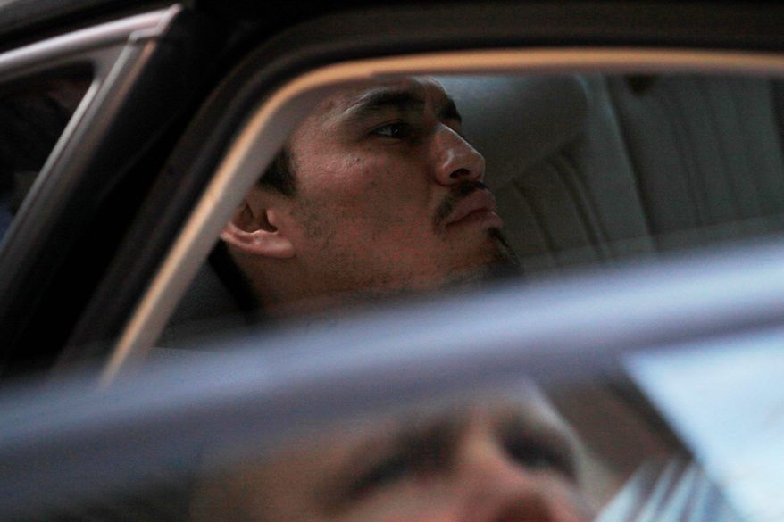 Ingmar Guandique, who is accused of killing Chandra Levy, is seen being taken by police from the Violent Crimes Unit in D.C. on April 22, 2009. (Associated Press) **FILE**
