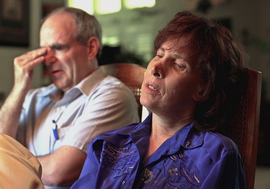 Robert Levy weeps as he and his wife, Susan, remember their missing daughter, Chandra, during an interview July 13, 2001, at their home in Modesto, Calif. A police investigation was active and a grand jury was examining the case. (Associated Press)