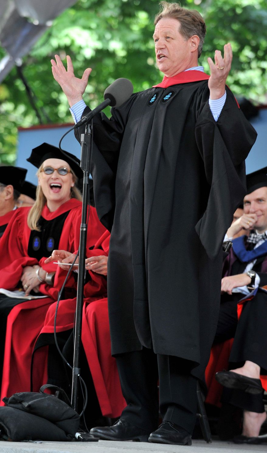 """Jimmy Tingle, making Meryl Streep laugh at Harvard's May commencement, says it's hard to satirize an """"underdog"""" president. (Associated Press)"""