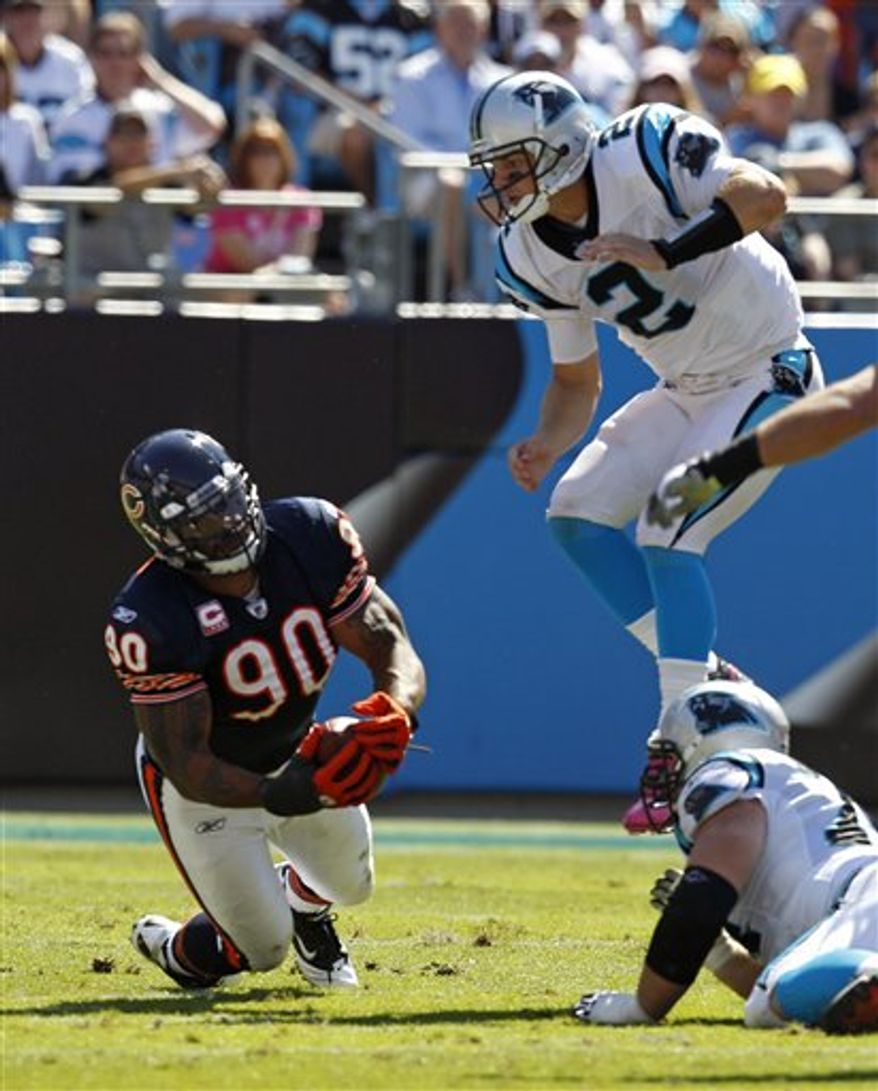 Carolina Panthers quarterback Jimmy Clausen (2) is sacked by Chicago Bears linebacker Pisa Tinoisamoa (59) in the second half of the Bears' 23-6 win in an NFL football game in Charlotte, N.C., Sunday, Oct. 10, 2010. (AP Photo/Chuck Burton)