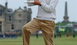 Germany's Martin Kaymer poses with the trophy after his victory during the Alfred Dunhill Links Championship at St Andrews Golf Course, Scotland, Sunday Oct. 10, 2010. (AP Photo/Lynne Cameron/PA)