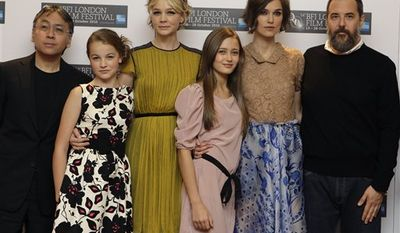 Japanese novelist Kazuo Ishiguro poses with British actresses Isobel Meikle-Small, Carey Mulligan, Ella Purnell, and Keira Knightley, alongside Director Mark Romanek, from left, during a photocall for the film 'Never Let Me Go', at a central London cinema, Wednesday, Oct. 13, 2010, ahead of the London Film Festival. (AP Photo/Joel Ryan)
