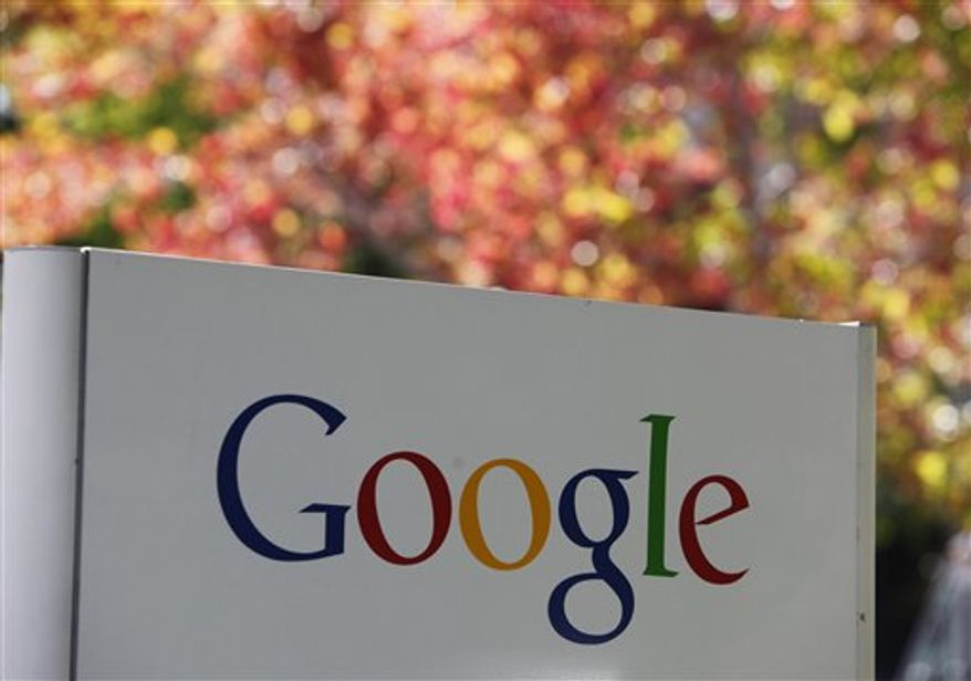 In this photo taken Friday, Oct. 8, 2010, a sign at Google headquarters in Mountain View, Calif. is shown. Google Inc.'s third-quarter earnings climbed 32 percent to beat Wall Street's expectations as companies spent more to advertise to Web surfers. (AP Photo/Paul Sakuma)