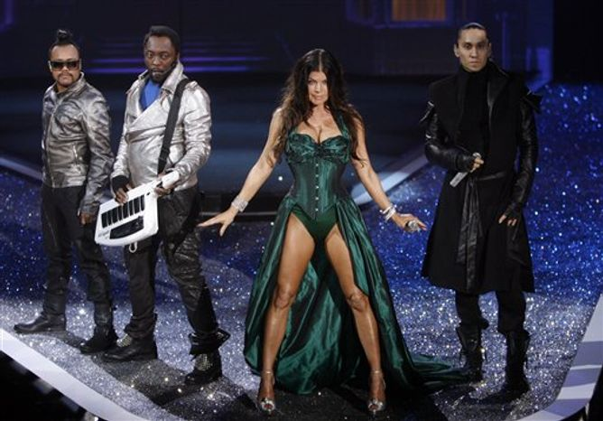 FILE-  This Nov. 19, 2009 file photo shows members of The Black Eyed Peas, from left, apl.de.ap, will.i.am, Fergie and Taboo, as they perform during the Victoria's Secret Fashion Show at the Lexington Armory in New York. Katy Perry, Akon and model Adriana Lima in a $2 million fantasy bra are among the highlights planned for this year's Victoria's Secret fashion show.    (AP Photo/Jason DeCrow, FILE)
