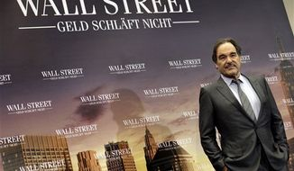 "**FILE** Director Oliver Stone poses for the photographers during a photo-call for the movie ""Wall Street: Money Never Sleeps"" in Berlin on Oct. 12, 2010. (Associated Press)"