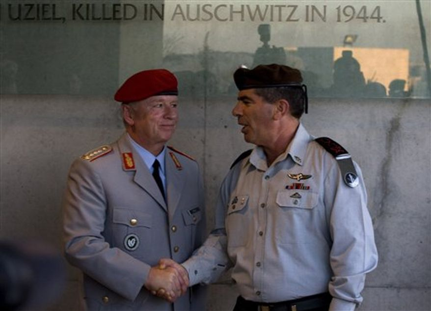 German Bundeswehr inspector general Volker Wieker, left, shakes hands with Israel's chief of Staff Lt. Gen. Gabi Ashkenazi during a visit to the Yad Vashem Holocaust memorial in Jerusalem, Tuesday, Oct. 12, 2010. Germany's military chief, Volker Wieker, visited Israel's national Holocaust memorial, Yad Vashem, on Tuesday. (AP Photo/Sebastian Scheiner)
