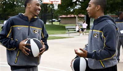 In this photo made Oct. 2, 2010, Missouri head basketball coach Mike Anderson, right, watches freshman player Phil Pressey during a community basketball workshop at Douglas Park, in Columbia, Mo.  (AP Photo/Patrick T. Fallon)