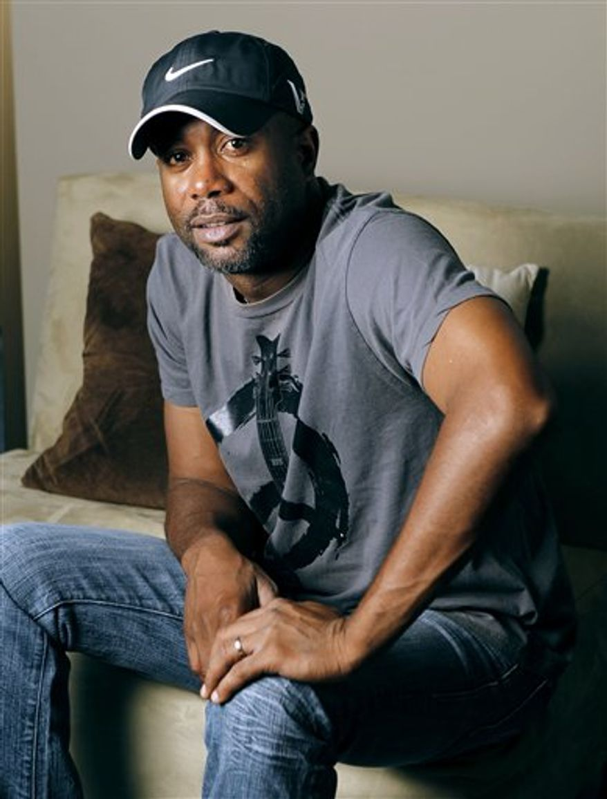 "This Oct. 13, 2010 photo shows Darius Rucker in Nashville, Tenn. Rucker has spent the last few years reinventing himself as a country star. He's had a platinum debut, No. 1 hits and his follow-up, ""Charleston, SC 1966,"" debuted this week with high expectations, The Associated Press reports Thursday, Oct. 14, 2010. (AP Photo/Mark Humphrey)"