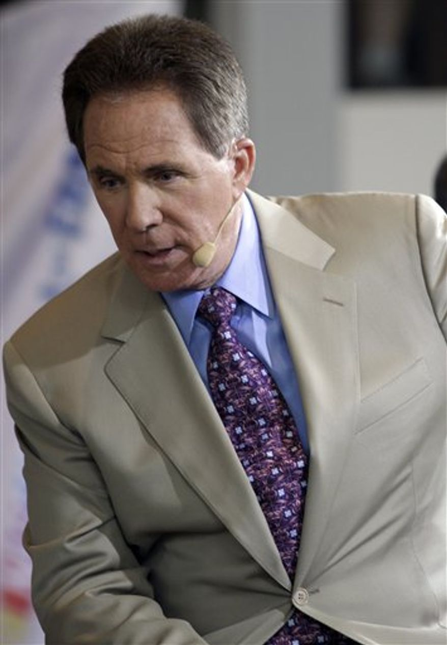 In this photo taken Oct. 13, 2010, Darrell Waltrip looks on during an announcement of the second induction class at the NASCAR Hall of Fame in Charlotte, N.C.  Waltrip did enough on the track to earn a spot in NASCAR's Hall of Fame. But when the voters passed Wednesday on putting him in, it sent a clear message that not everybody loves 'ol DW. (AP Photo/Terry Renna)