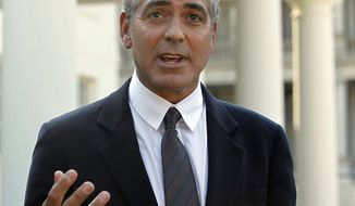 Actor George Clooney speaks to reporters after meeting with President Barack Obama about his recent trip to Sudan at the White House in Washington, Tuesday, Oct. 12, 2010. (AP Photo/Charles Dharapak)