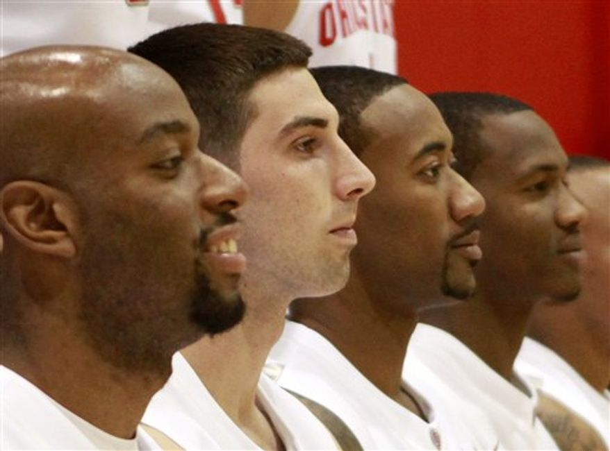 Ohio State players, from left, Dallas Lauderdale, Jon Diebler, David Lighty and William Buford pose for the team photo during the NCAA college basketball squad's media day Thursday, Oct. 14, 2010, in Columbus, Ohio. (AP Photo/Terry Gilliam)
