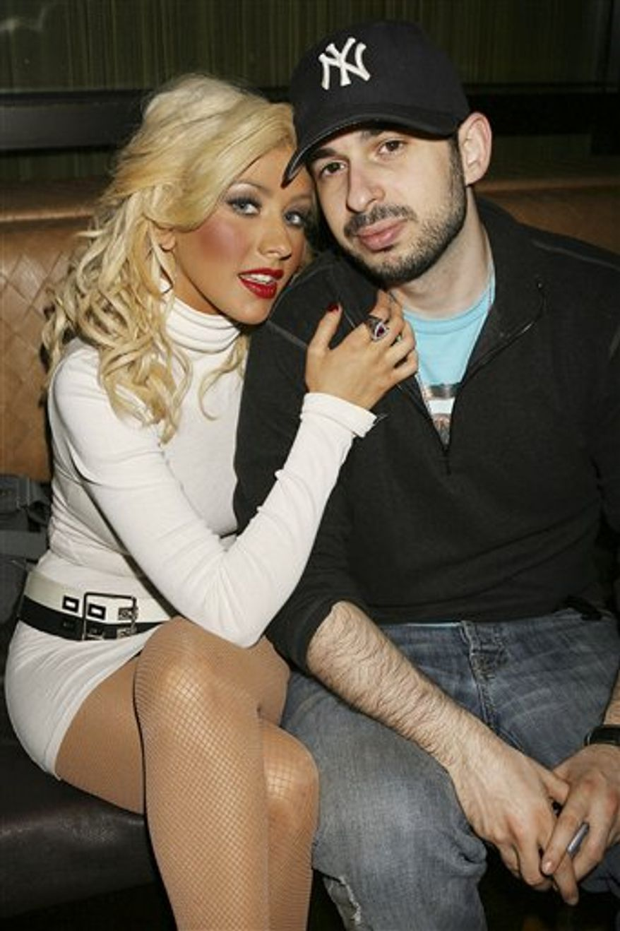 FILE - In this March 23, 2007 file photo originally provided by Starpix, singer Christina Aguilera and her husband Jordan Bratman attend a party at the Marquee club in New York. Court records show Aguilera and Bratman have finalized their divorce. (AP Photo/Dave Allocca, Starpix, File)