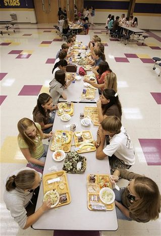 FILE - In this Aug. 18, 2006 file photo, students eat lunch at Pleasant View Middle School in Springfield, Tenn. The U.S. government is trying new approaches to get kids to choose healthier foods. (AP Photo/Mark Humphrey, File)