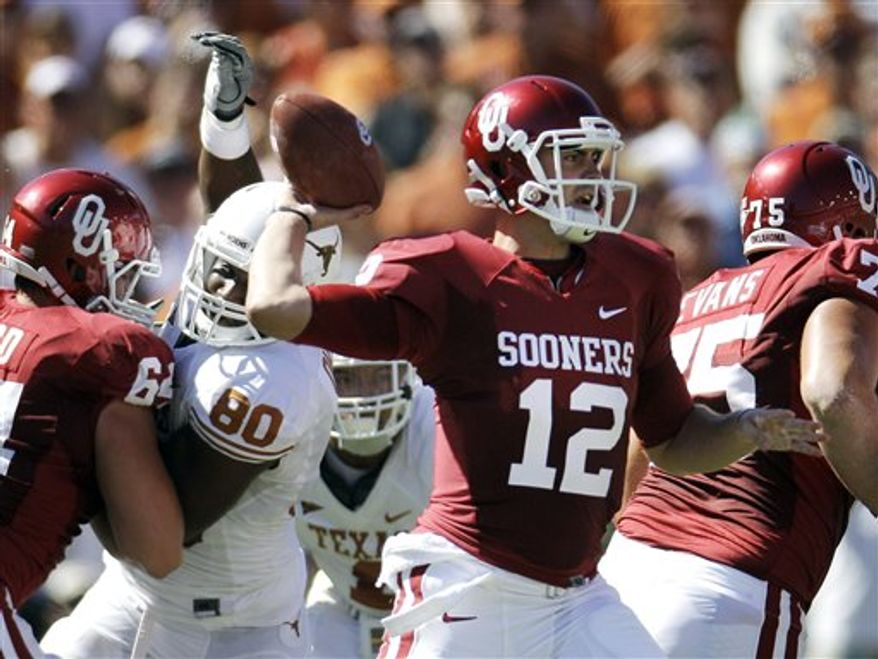 FILE - In this Oct. 2, 2010, file photo, Oklahoma quarterback Landry Jones (12) throws from the pocket during the first half of an  NCAA football game against Texas at the Cotton Bowl in Dallas. The Sooners are getting back to gashing defenses with their hurry-up offense again, just as they did while setting scoring records during Sam Bradford's Heisman Trophy season two years ago. (AP Photo/LM Otero, File)