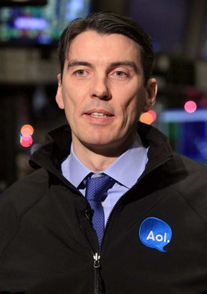 FILE - In this Dec. 10, 2010 file photo, AOL Chairman and CEO Tim Armstrong is seen on the floor of the New York Stock Exchange. Investors are running up the price of Yahoo Inc. shares after a report saying AOL Inc. and a group of private equity firms may bid for the Web company.(AP Photo/Richard Drew, file)