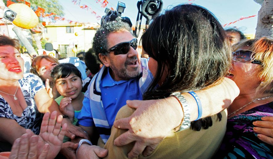 Luis Urzua embraces his wife, Carmen Rosa, as he arrives home in Copiapo. Mr. Urzua was the shift foreman, praised for leading the miners throughout their ordeal underground. (Associated Press)
