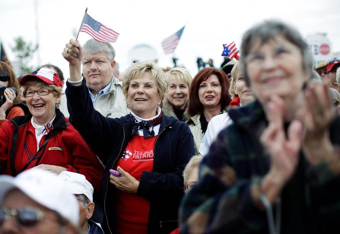 ASSOCIATED PRESS PHOTOGRAPHS Attendees show their support during a rally launching a Tea Party Express bus tour Monday in Reno, Nev. The tour will make stops in at least 15 states before reaching Concord, N.H., the day before the midterm elections.