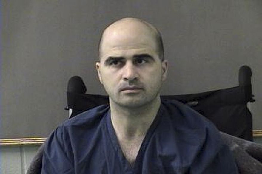 ** FILE ** U.S. Army Maj. Nidal Hasan is pictured at the Bell County Jail in Belton, Texas, in April 2010. (AP Photo/Bell County Sheriff's Department)
