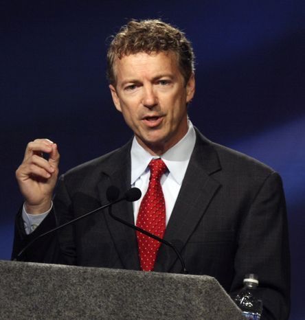 In this Oct. 11, 2010, file photo, Kentucky Republican U.S. Senate candidate Rand Paul speaks during a debate with Democrat Jack Conway at Northern Kentucky University in Highland Heights, Ky. (AP Photo/David Kohl, File)