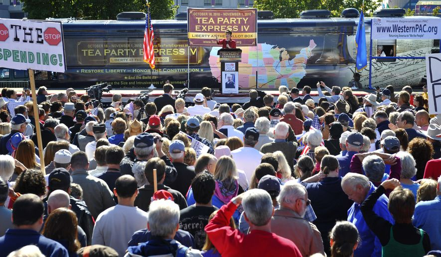 Former Alaska governor Sarah Palin speaks to the crowd during the kickoff of the nationwide Tea Party Express bus tour in Reno, Nev., Monday, Oct. 18, 2010. (AP Photo/Scott Sady)