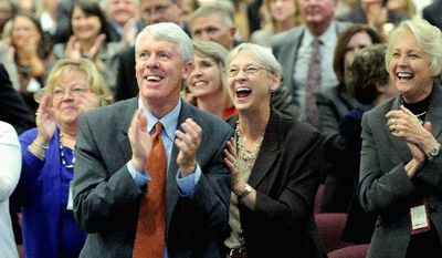 Dale Robbins, an associate superintendent at Gwinnett County Public Schools in Georgia, cheers the announcement of the Broad Prize for Urban Education with Celeste Strohl and Carol Grady (right). (Gwinnett Daily Post via Associated Press)