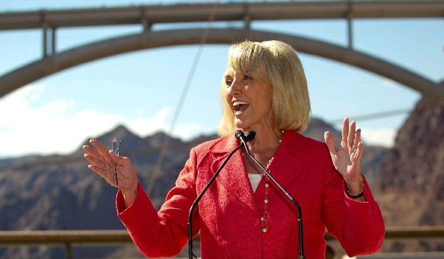 Arizona Gov. Jan Brewer improved her chances of keeping her seat when she signed into law a tough enforcement measure against illegal immigration. Polls show the Republican incumbent leading the race. (Arizona Republic via Associated Press)