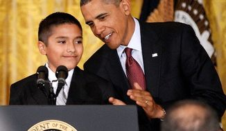 President Obama is introduced by Javier Garcia of Brownsville, Texas, before signing the Executive Order on the White House Initiative on Educational Excellence for Hispanics. (Associated Press)