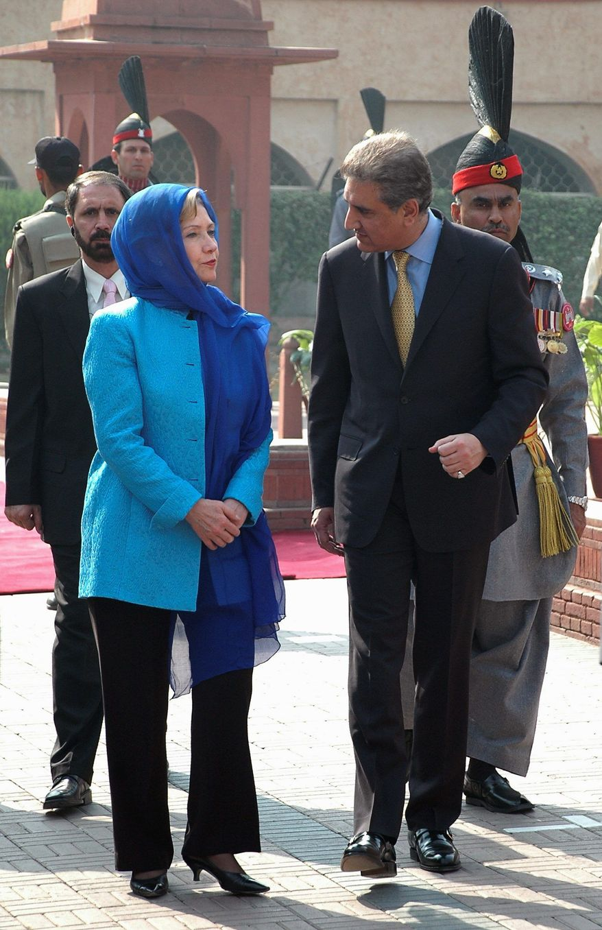 Secretary of State Hillary Rodham Clinton chats with Pakistani Foreign Minister Shah Mahmood Qureshi. (AP Photo)
