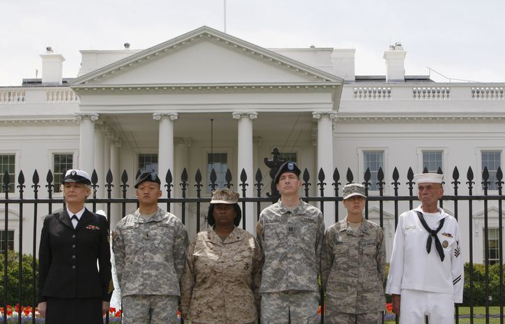 ** FILE ** Standing together on April 16, 2010, after handcuffing themselves to the White House fence to protest for gay rights are (from left) Petty Officer Autumn Sandeen, Lt. Dan Choi, Cpl. Evelyn Thomas, Capt. Jim Pietrangelo II, Cadet Mara Boyd and Petty Officer Larry Whitt. (AP Photo/Pablo Martinez Monsivais)