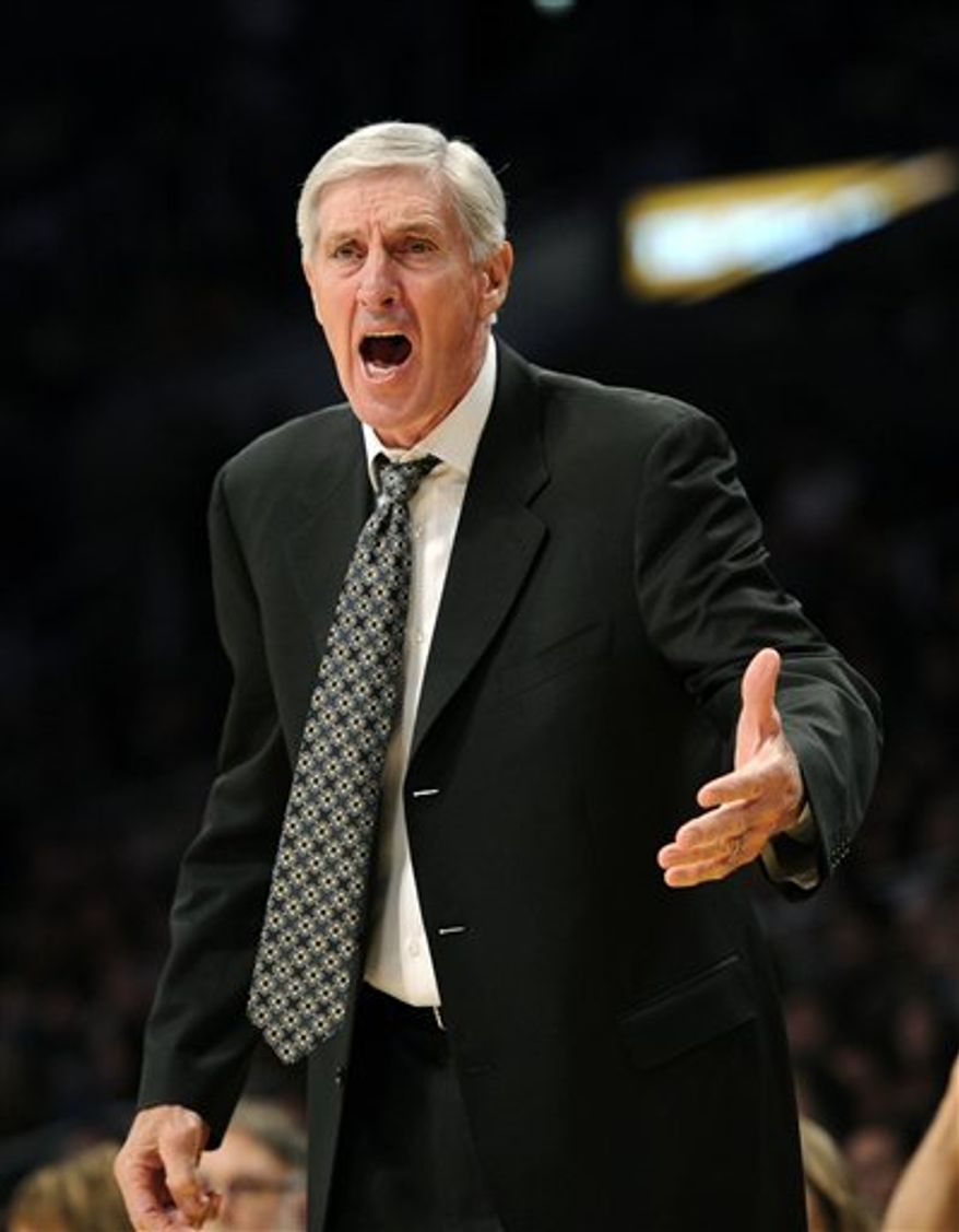 Utah Jazz coach Jerry Sloan yells at a referee during the first half of a preseason NBA basketball game against the Los Angeles Lakers, Sunday, Oct. 17, 2010, in Los Angeles. (AP Photo/Mark J. Terrill)