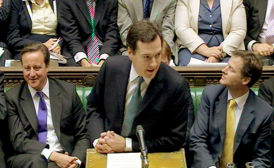 George Osborne, Britain's Treasury chief (center), delivers the Comprehensive Spending Review in London on Wednesday. Mr. Osborne ordered $128 billion in spending cuts through 2015. (Associated Press)