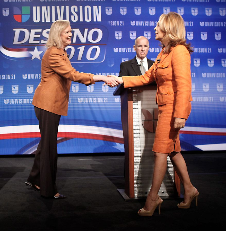Meg Whitman, the Republican candidate for California governor (left), shakes hands with debate moderator Maria Elena Salinas, before the start of her debate with Jerry Brown on Univision. (Associated Press)