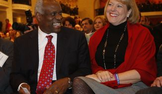 In this Nov. 15, 2007, photo, Supreme Court Justice Clarence Thomas, left, sits with his wife Virginia Thomas, as he is introduced at the Federalist Society in Washington, where he spoke about his new book and took questions from the audience. Virginia Thomas is asking Anita Hill to apologize for accusing the justice of sexually harassing her, 19 years after Justice Thomas' confirmation hearing spawned a national debate about harassment in the workplace. (AP Photo/Charles Dharapak)