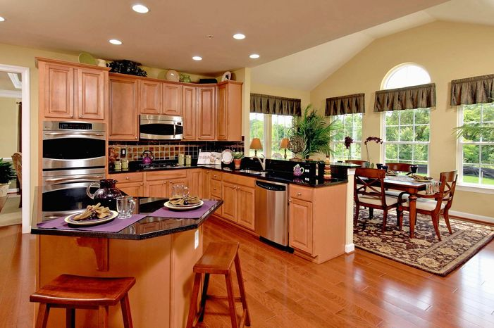 The center-island kitchen in the Avalon model at Brunswick Crossing has maple cabinets, recesse