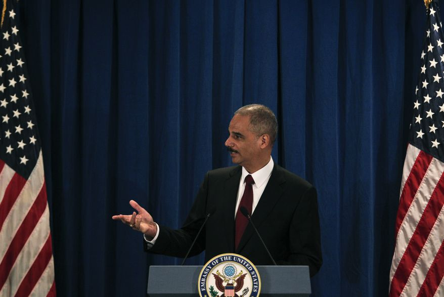 U.S. Attorney General Eric H. Holder Jr. speaks during a press conference at the U.S. Embassy in Beijing, China, Thursday, Oct. 21, 2010. (AP Photo/Alexander F. Yuan)
