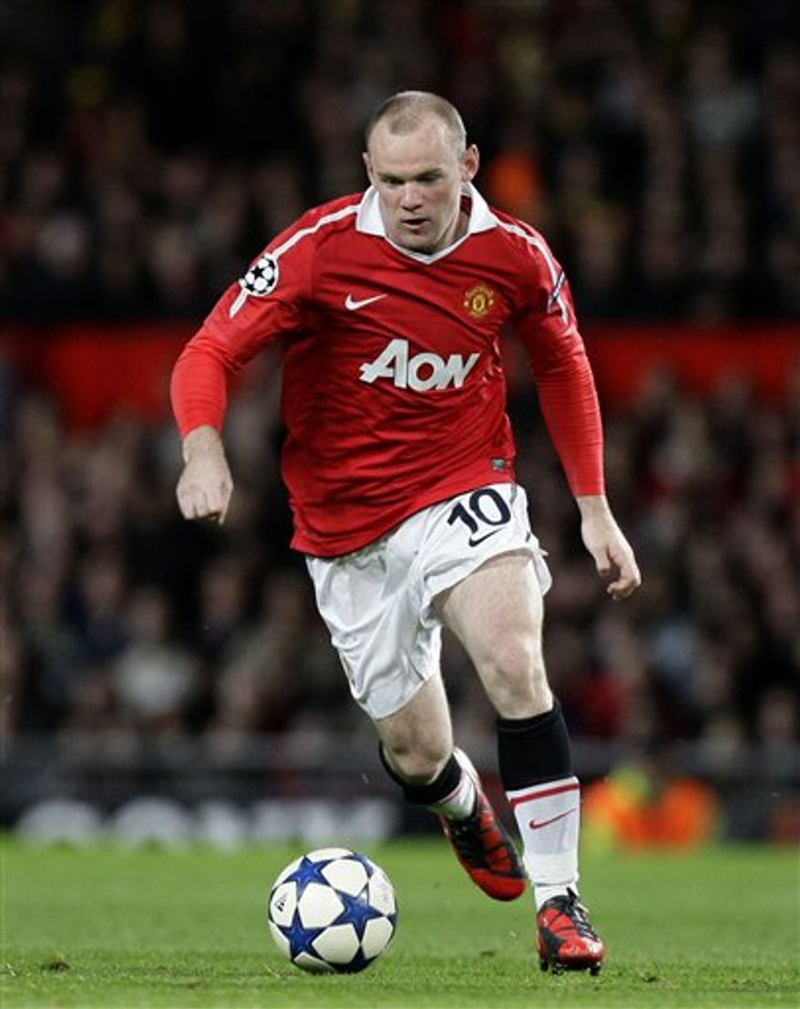 """File - In this Tuesday, Sept. 14, 2010 file photo, Manchester United's Wayne Rooney plays during his team's Champion's League League soccer match against Rangers at Old Trafford Stadium, Manchester, England. Manchester United said Friday Oct. 22, 2010, that Rooney has agreed to a new five-year contract, keeping him at the Premier League club until June 2015. After holding talks with United, Rooney says he is """"delighted to sign another deal at United ... I've talked to the manager and the owners and they've convinced me this is where I belong.""""  The England striker said earlier this week he did not intend to extend his contract at United beyond 2012 because he was unhappy at the club's lack of ambition.(AP Photo / Jon Super, file)"""