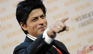 """Bollywood actor Shah Rukh Khan and  co-star actress Priyanka Chopra, right, pose during a photo call in Berlin, Germany, on  Friday, Oct. 22, 2010. Shah Rukh Khan is working on his new action movie """"Don-2"""" in Berlin, where some of the scenes are shot.  (AP Photo/Kai-Uwe Knoth)"""