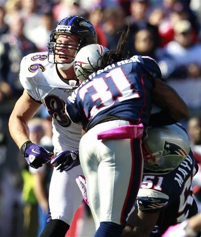 In this photo taken Sunday, Oct. 17, 2010, New England Patriots safety Brandon Meriweather (31) hits helmet-to-helmet with Baltimore Ravens tight end Todd Heap (86) in the second quarter of an NFL football game, in Foxborough, Mass. Meriweather was fined $50,000 by the NFL on Tuesday, Oct. 19, 2010, for his helmet-to-helmet hit .on Heap. (AP Photo/Michael Dwyer)