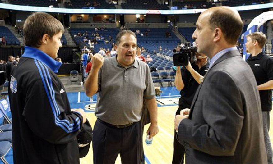 Fans react to the announced cancellation of a preseason NBA basketball game between the Orlando Magic and Miami Heat, Friday, Oct. 22, 2010, in Tampa, Fla. (AP Photo/Mike Carlson)
