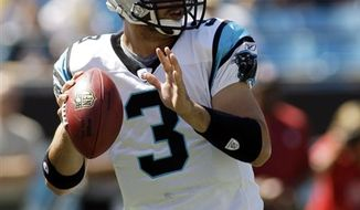 FILE - This Sept. 19, 2010, file photo shows Carolina Panthers quarterback Matt Moore during the first half of an NFL football game against the Tampa Bay Buccaneers,  in Charlotte, N.C.  The winless Panthers are changing quarterbacks again, benching struggling rookie Jimmy Clausen and turning again to Moore. Coach John Fox announced Monday, Oct. 18, 2010,  that Moore will start on Sunday against San Francisco. (AP Photo/Rick Havner, File)