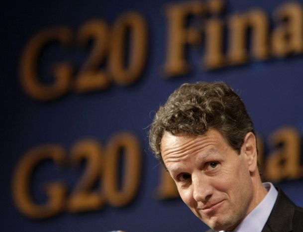 ** FILE ** Treasury Secretary Timothy F. Geithner listens to questions at a press conference during a meeting of the G-20 finance ministers and central bank governors in Gyeongju, South Korea, on Saturday, Oct. 23, 2010. (AP Photo/Ahn Young-joon)