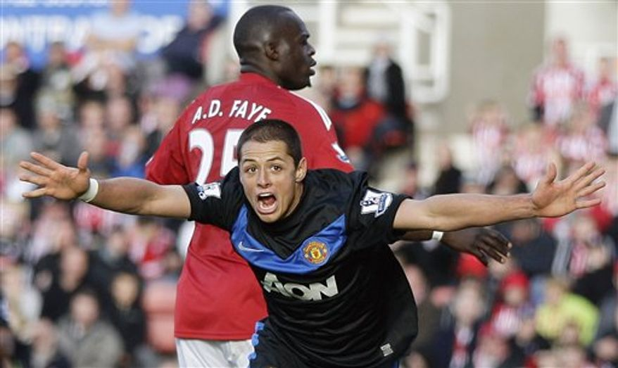 Manchester United's Javier Hernandez celebrates scoring his teams second goal during their English Premier League soccer match against Stoke City at the Britannia stadium, Stoke, England. Sunday, Oct. 24, 2010. (AP Photo/Simon Dawson)