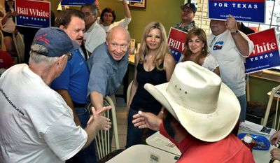 Associated Press photographs Texas Democratic gubernatorial candidate Bill White (center) greets supporters Saturday at Los Generales Restaurant in Laredo, Texas, before joining them on a walk throughout Laredo's west side.