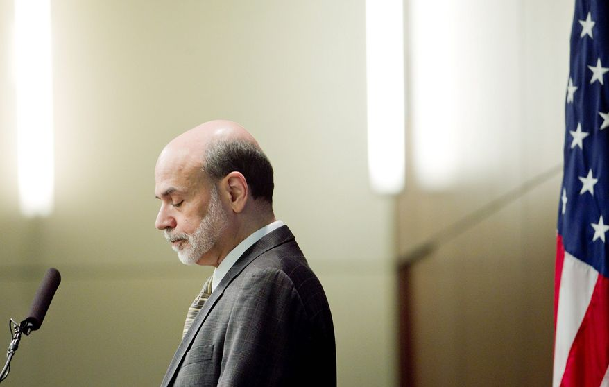 "BLOOMBERG Ben S. Bernanke, Federal Reserve chairman, speaks at the ""Mortgages and the Future of Housing Finance"" symposium in Arlington, Va. He said the central bank and other regulators are examining financial firms' home-foreclosure practices."
