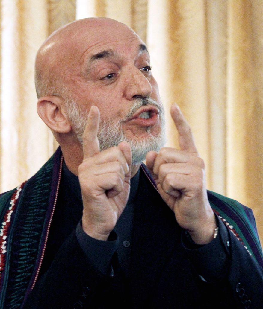 """Afghan President Hamid Karzai says Monday that he is """"grateful"""" for financial support from Iran, used to maintain the presidential office, and that """"this is nothing hidden."""" (Associated Press)"""